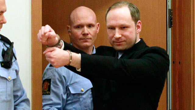 PHOTO: Anders Behring Breivik, a right-wing extremist who confessed to a bombing and mass shooting that killed 77 people, July 22, 2011, gestures as he arrives for a detention hearing at a court in Oslo, Norway, Feb. 6, 2012.