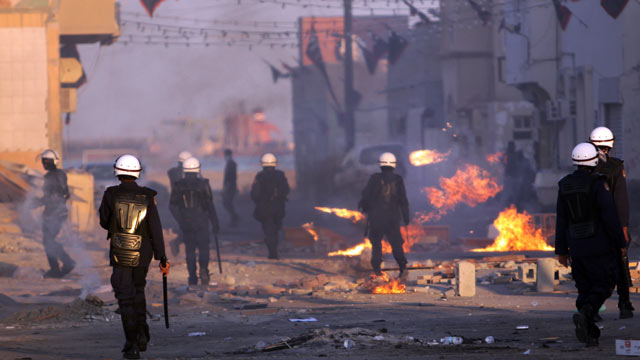 PHOTO: Riot police pursue Bahraini anti-government protesters during clashes, Jan. 27, 2012, in the eastern village of Sitra, Bahrain.