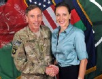 "PHOTO: Davis Petraeus, left, shaking hands with Paula Broadwell, co-author of  ""All In: The Education of General David Petraeus."""
