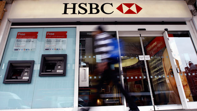 PHOTO: This is a Feb. 27, 2012 file photo of a pedestrian passes a branch of HSBC bank in London; HSBC avoided a legal battle that could further savage its reputation and undermine confidence in the global banking system by agreeing on Dec. 11, 2012 to p