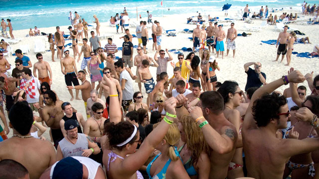PHOTO: Spring break revelers dance at the beach in the resort city of Cancun, Mexico.