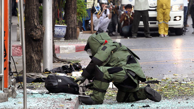 PHOTO: A Thai Explosive Ordnance Disposal (EOD) official examines a backpack that was left on the bomb site by a suspected bomber in Bangkok, Thailand, Feb. 14, 2012.