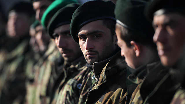 PHOTO: Newly graduated Afghan National Army soldiers attend their graduation ceremony in Kabul on January 26, 2012.