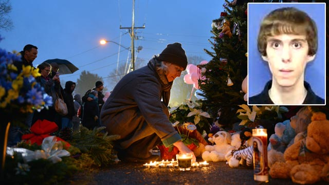 PHOTO: Candles are lit at a memorial near the Newtown Firehouse, Dec. 16, 2012, in Newtown, Conn.