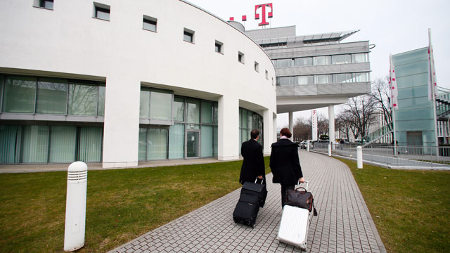 PHOTO: Visitors arrive at the headquarters of Deutsche Telekom AG in Bonn, Germany, Feb. 28, 2013.