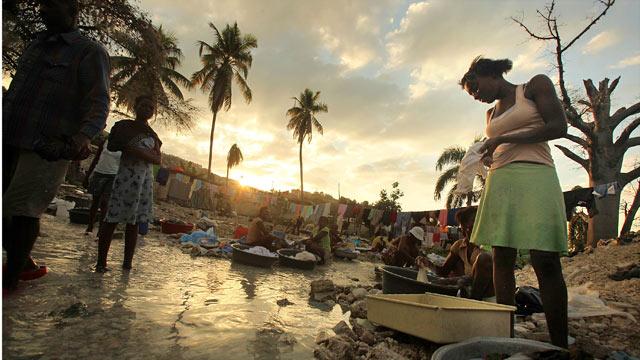 PHOTO: Haitians wash clothes in a stream Jan. 8, 2011 in Port-au-Prince, Haiti.