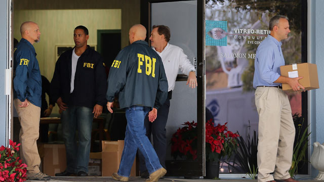 PHOTO: FBI agents and other law enforcement officials investigate the medical-office complex of Dr. Salomon Melgen who has possible ties to U.S. Sen. Bob Menendez (D-NJ) on January 30, 2013 in West Palm Beach, Fla.