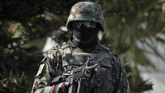 PHOTO: A Mexican marines stand stand guard in streets of Veracruz State, Mexico on Jan. 24, 2012.