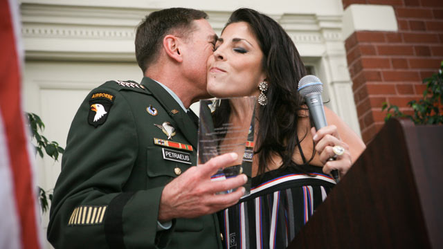 PHOTO: General David Petraeus kisses Jill Kelley after accepting community service award presented at Kelleys home during the summer of 2011.