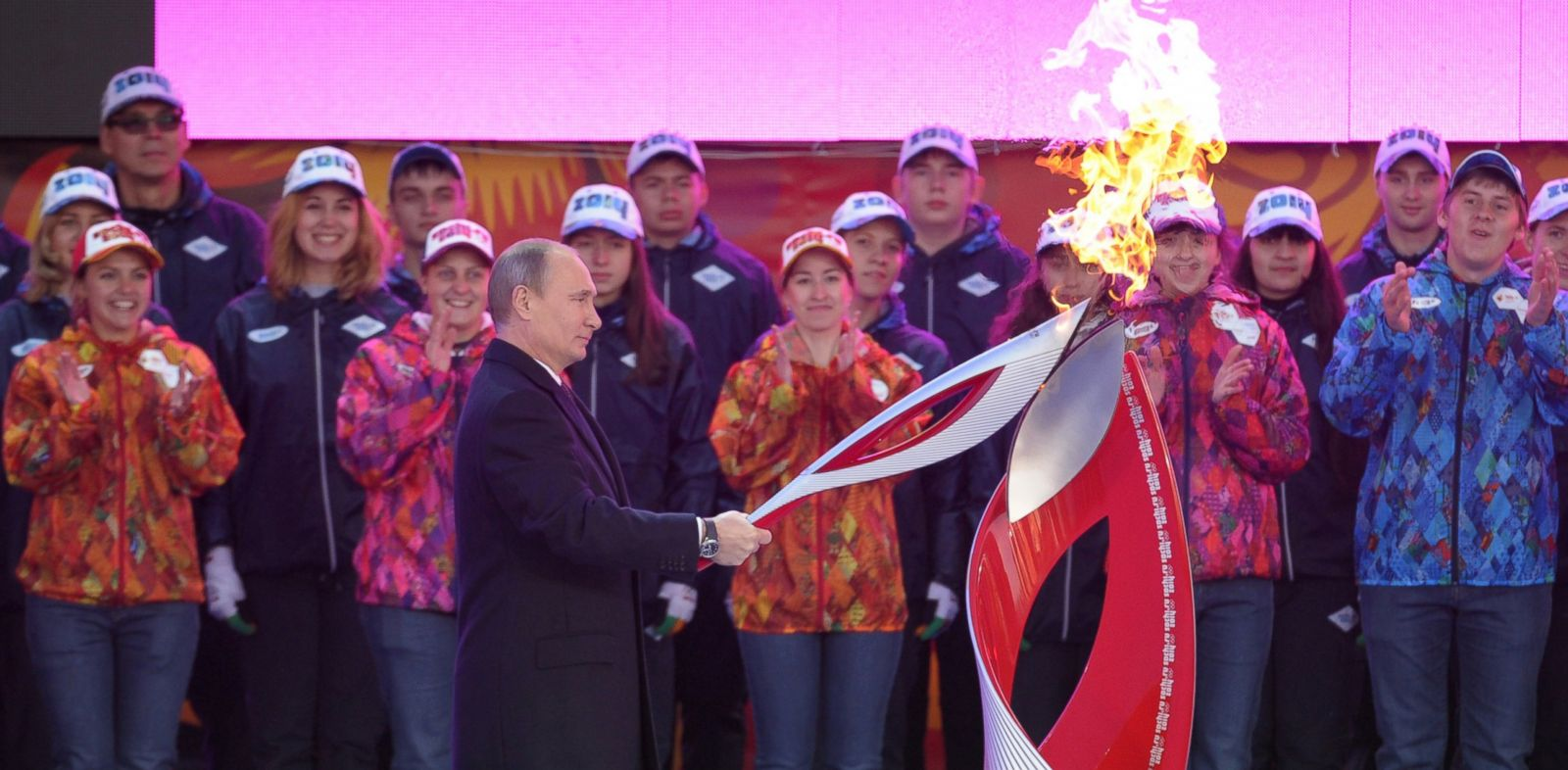 PHOTO: Russias President Vladimir Putin lights the Olympic torch to mark the start of the Sochi 2014 Winter Olympic torch relay across Russia, Oct. 6, 2013, in Moscow.