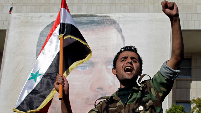 PHOTO: A Syrian soldier shouts slogans in front of a picture of President Bashar al-Assad during a pro-regime rally in Damascus in this Dec. 2, 2011 file photo.
