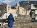 PHOTO: A lone woman in a burqa walks past the rubble from a November 23 suicide truck bomb in the capital of Wardak province, Dec. 2, 2012.