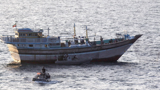 PHOTO: A Sailor aboard a safety boat observes a visit, board, search and seizure team assigned to the guided-missile destroyer USS Kidd (DDG 100) board the Iranian-flagged fishing dhow Al Molai, Jan. 5, 2012.