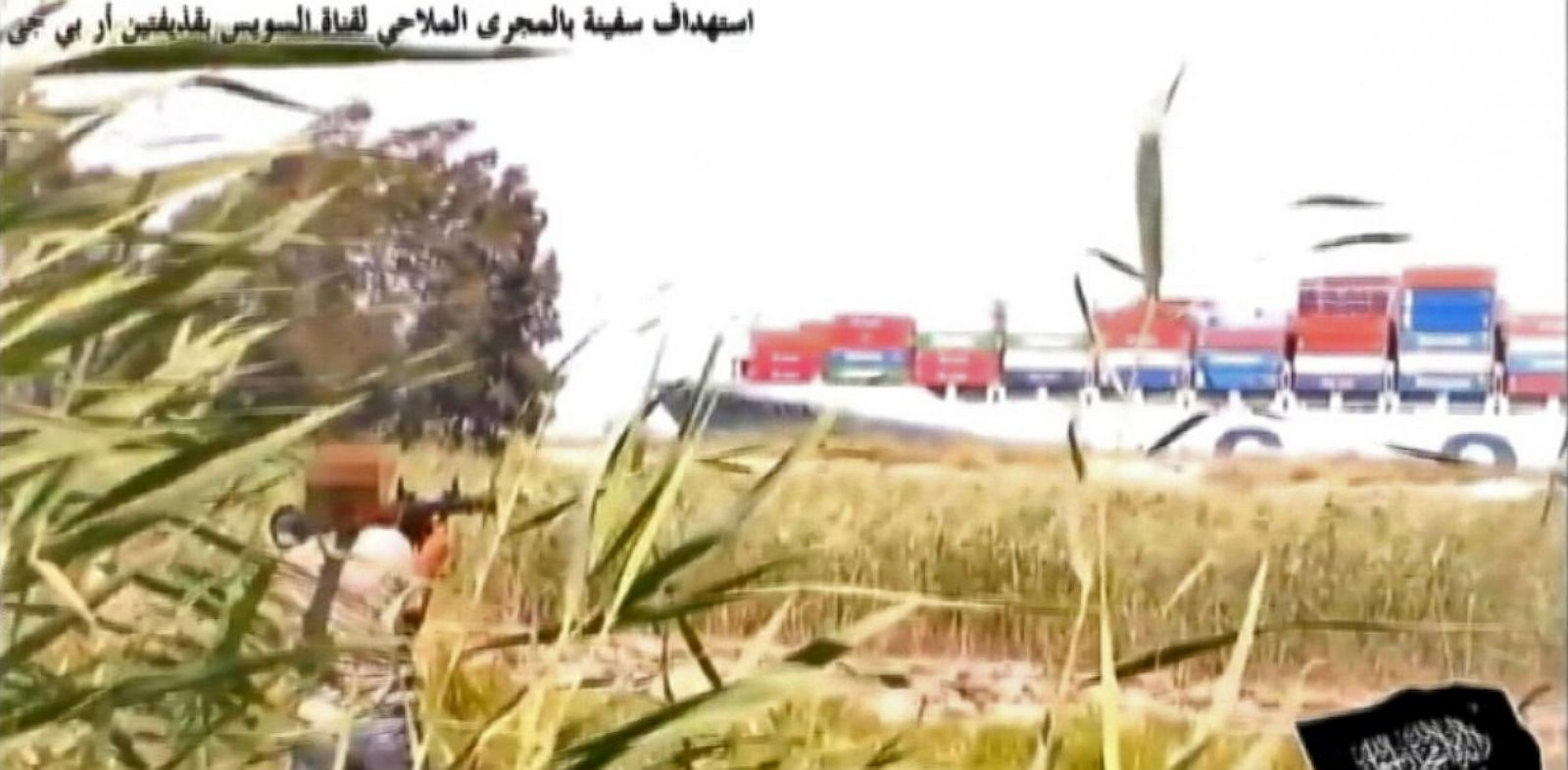 PHOTO: Person aims rocket propelled grenade launcher at ship in Suez Canal