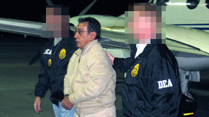 Mario Ernesto Villanueva Madrid is taken off a DEA jet in White Plains