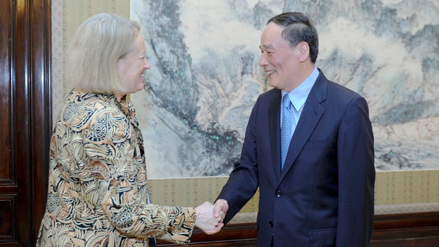 PHOTO: Chinese Vice Premier Wang Qishan (R) meets with Mary Schapiro, chair of the U.S. Securities and Exchange Commission (SEC), in Beijing, capital of China, July 2, 2012.