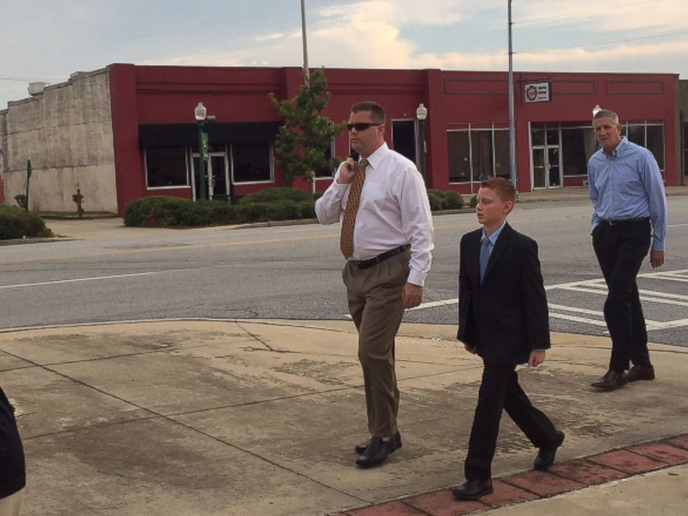 PHOTO: Peter Hurley and his son, Jake, walk to the courthouse in Albany, Georgia, Sept. 21, 2015. Jake Hurley was poisoned with Salmonella in 2009 through peanut products from the Peanut Corporation of America.
