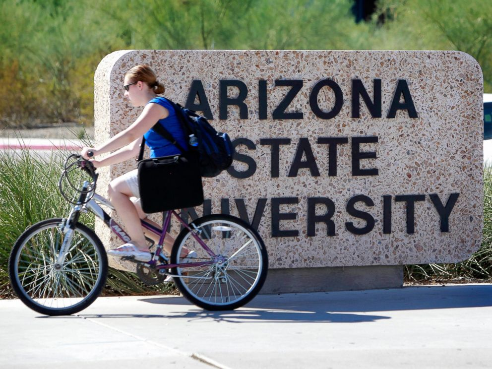 PHOTO: A student rides through the Arizona State University campus, Sept. 23, 2010, in Tempe, Ariz.