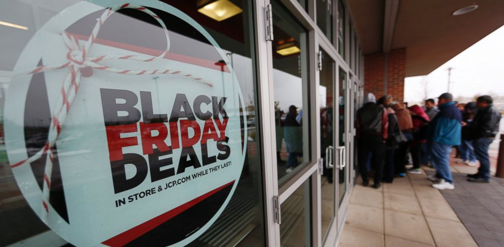 PHOTO: A sign promoting Black Friday specials is displayed in the window of a J.C. Penny store as shoppers queue up at the door for a 3 p.m. opening, Nov. 26, 2015, in Denver.