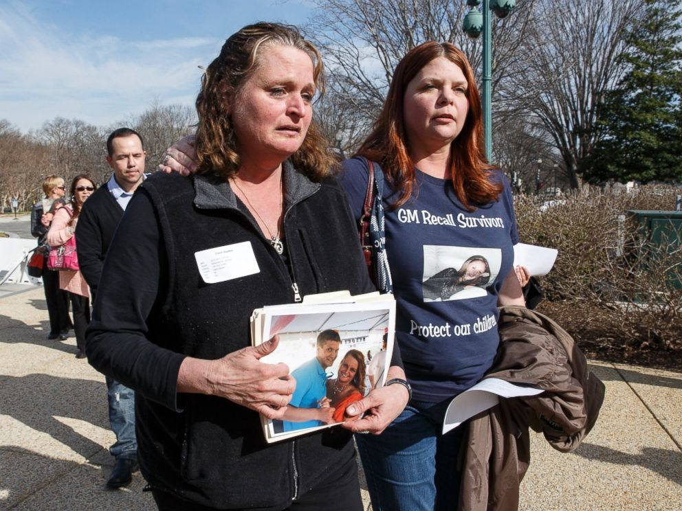 PHOTO: Cherie Sharkey, left, weeps for her son Michael Sharkey who died in his used 2006 Chevy Cobalt in Dresden, NY, as she walks with Laura Christian, of Harwood, Md., birth mother of Amber Marie Rose.