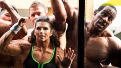 PHOTO: NASCAR driver Danica Patrick, center, wearing a muscle suit, appears with bodybuilders in an upcoming Super Bowl GoDaddy.com commercial shot on location in Long Beach, Calif.