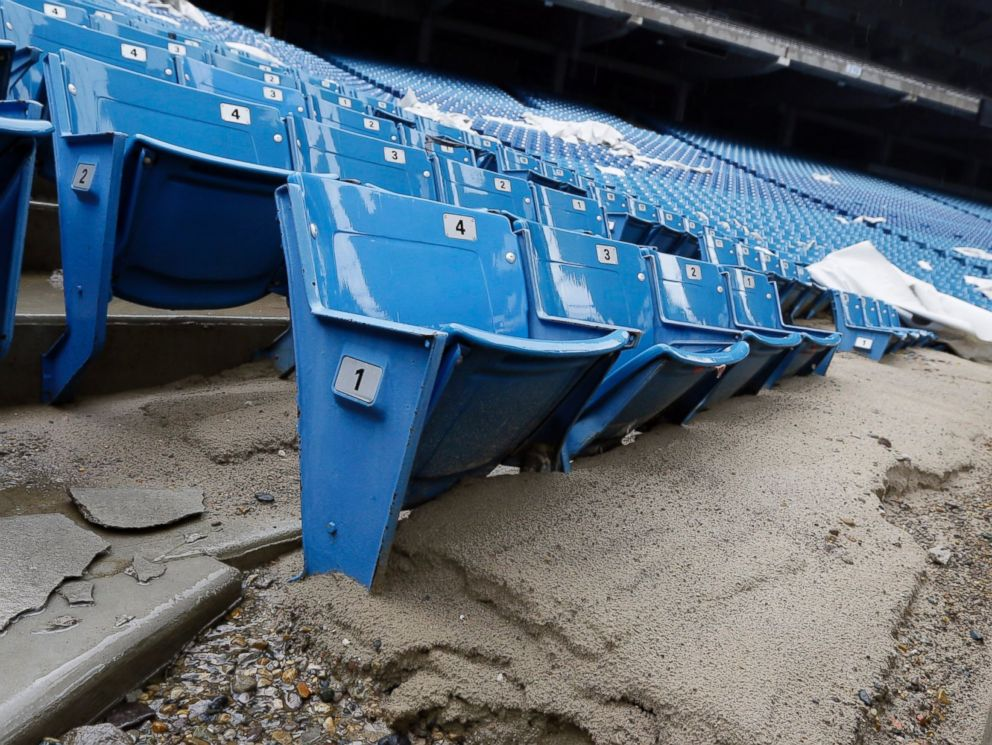 PHOTO: Foundation sand from cracked cement covers seats inside the Pontiac Silverdome in Pontiac, Mich. in this May 12, 2014 photo.