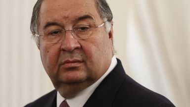 PHOTO: Uzbek-born Russian businessman Alisher Usmanov attends a meeting between Russian President Vladimir Putin and Crown Prince of Abu Dhabi Sheikh Abdullah bin Zayed al-Nahayan during their meeting at the Novo-Ogaryovo state residence outside Moscow.