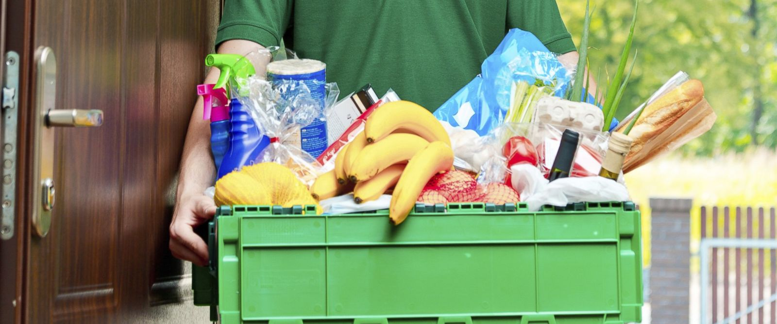 PHOTO: A man delivering groceries to a home is pictured in this stock image.