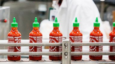 PHOTO: Bottles of the Sriracha hot sauce travel down a conveyor belt to be boxed for shipment at the Huy Fong Foods Inc. facility in Irwindale, Calif., Nov. 11, 2013.