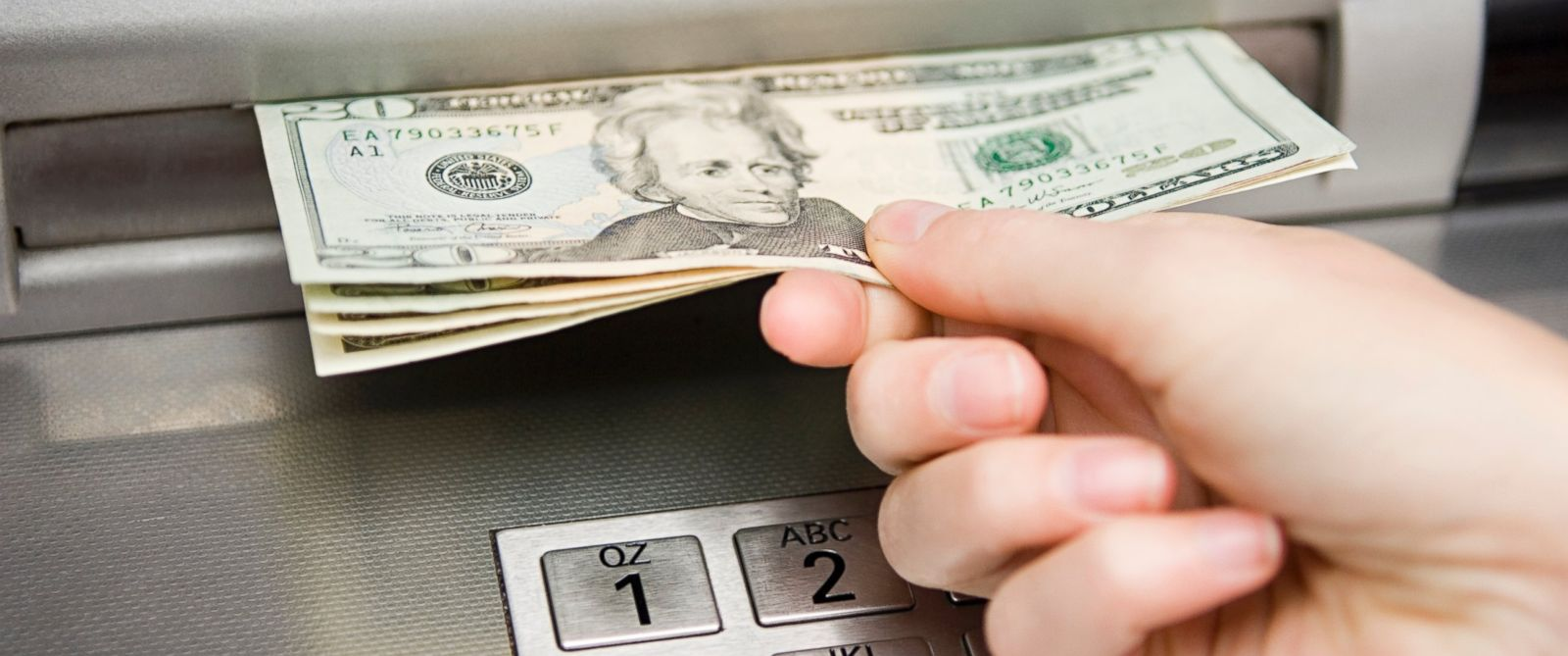 PHOTO: In this stock image, a person is seen withdrawing cash from an ATM machine.