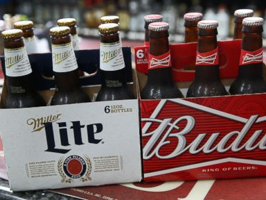 PHOTO: In this photo illustration, bottles of Budweiser and Miller Lite beer are seen Sept. 16, 2015 in Miami, Fla.