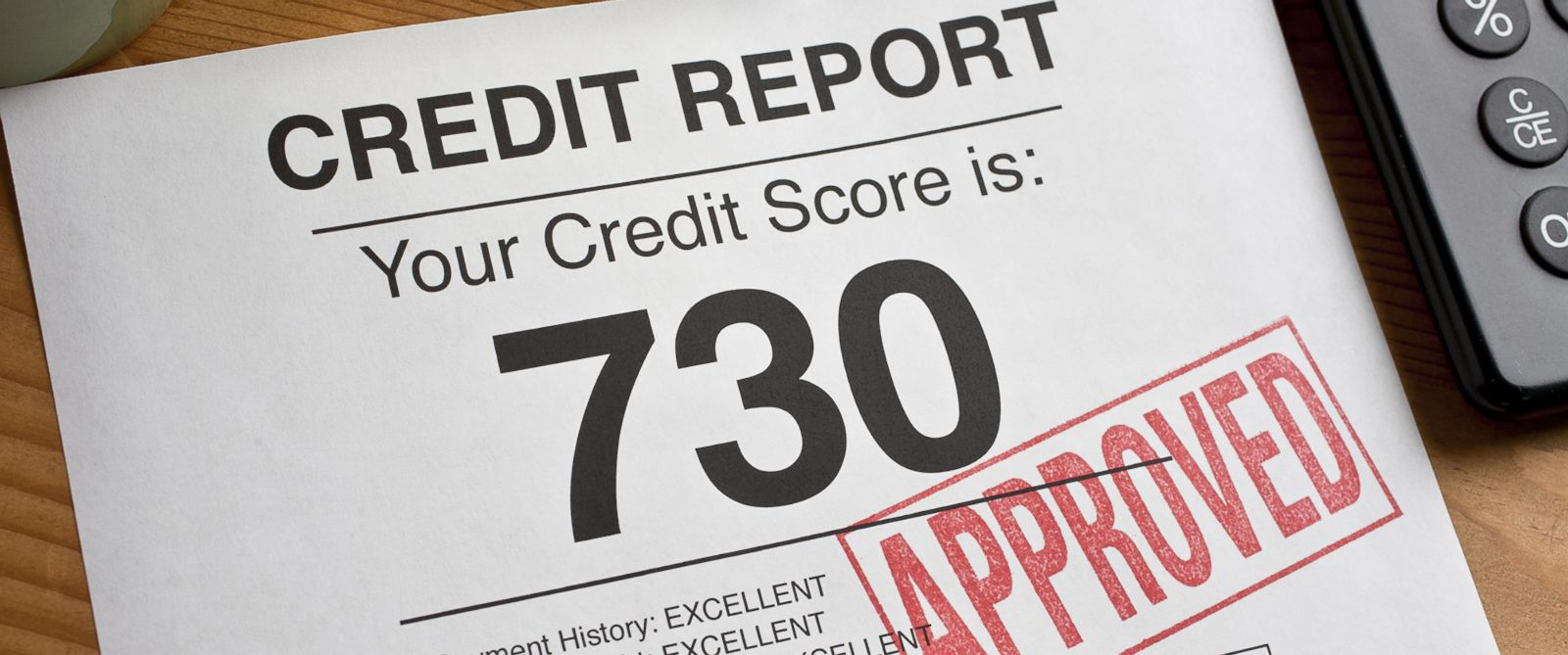 PHOTO: Approve is rubber stamped on a credit report with a high score.