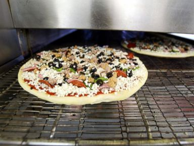 PHOTO:Dominos Pizza is seen baking in an oven in Miami, Fla., April 14, 2004.