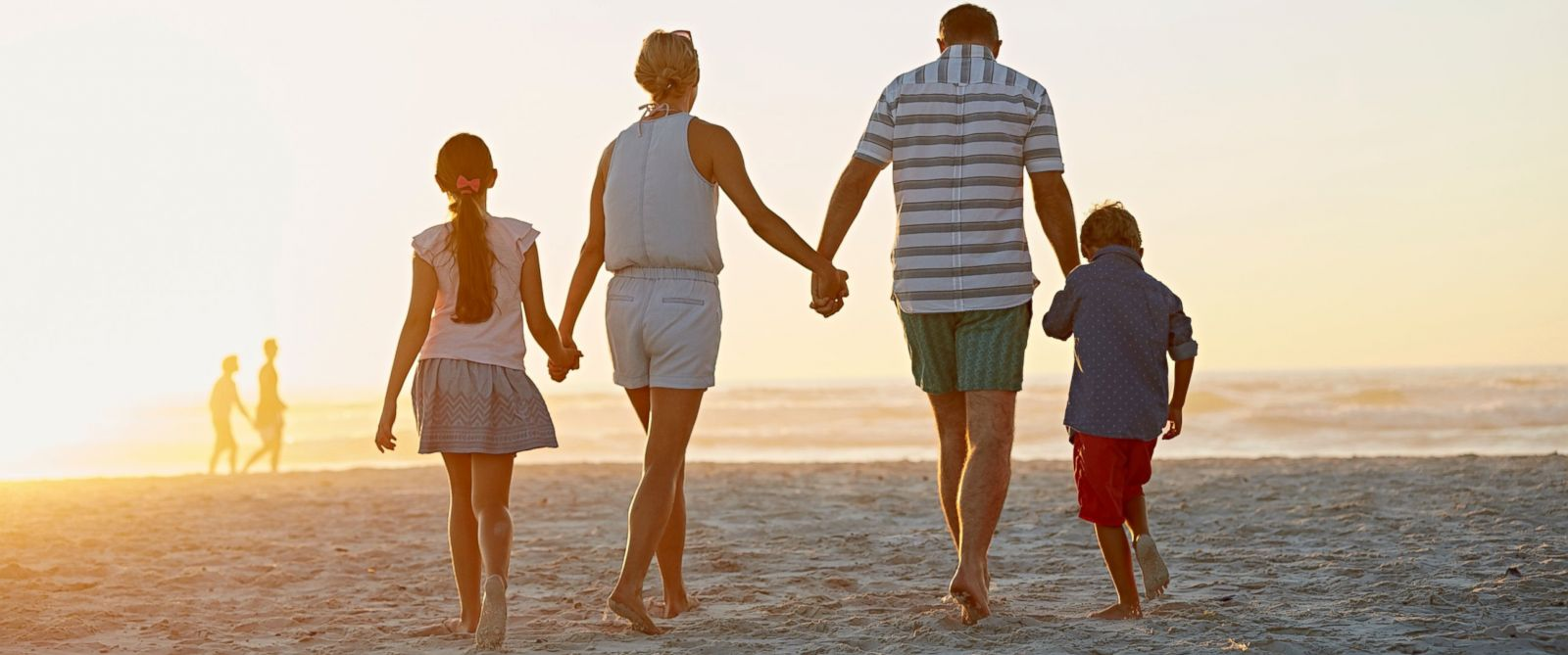 PHOTO:A family walks on the beach in this undated file photo.