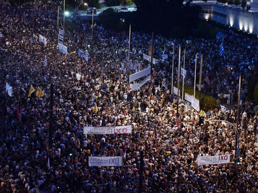 PHOTO: Carrying banners calling for a NO vote in the forthcoming referendum on bailout conditions set by the countrys creditors, protesters gather in front of the Greek parliament in Athens on June 29, 2015.