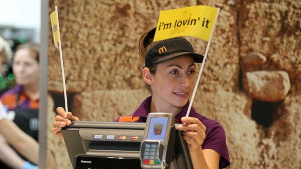 """PHOTO: An employee waves """"Im Lovin It"""" flags at a McDonalds in Moscow, Russia, on Oct. 28, 2014."""