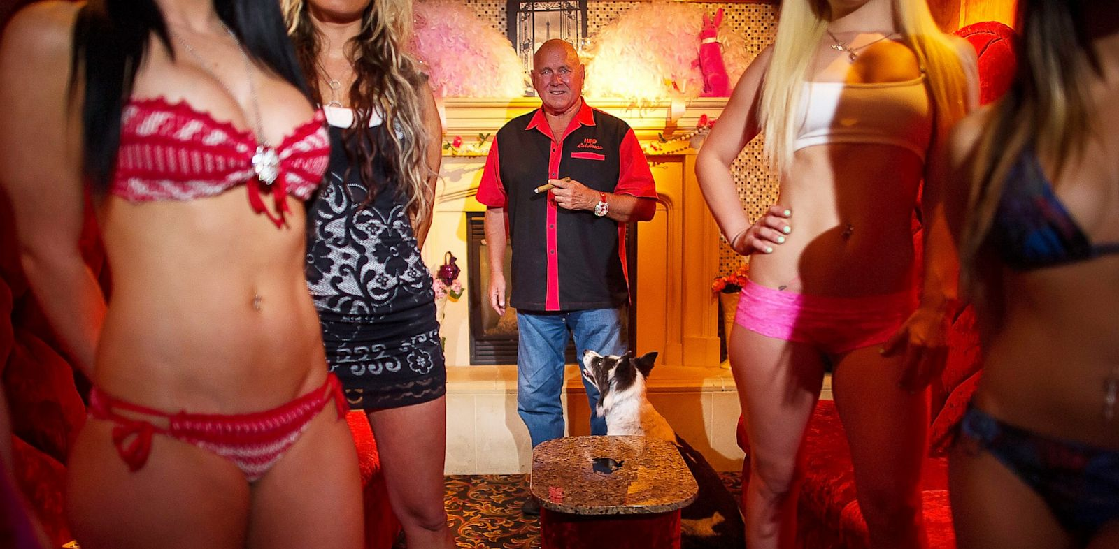 PHOTO: Dennis Hof, owner of the Moonlight Bunny Ranch, center, stands inside the Moonlight Bunny Ranch in Carson City, Nevada, Aug. 20, 2013.
