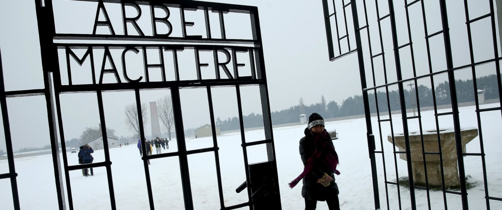 PHOTO: A visitor walks past a gate at the Sachsenhausen concentration camp memorial on Holocaust Memorial Day, Jan. 27, 2014 in Oranienburg, Germany.