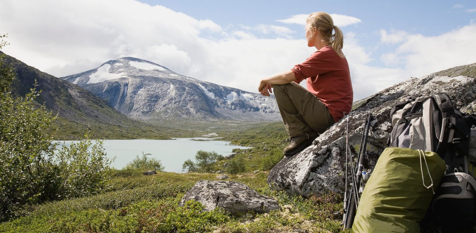 PHOTO: In this stock photo, a female hiker overlooks Strynefjellet mountain, Norway.