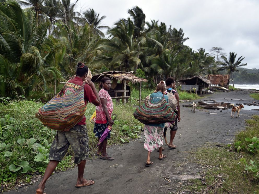 PHOTO: Women carry wood in the town of Kerema, Papua New Guinea, Sept. 5, 2014.