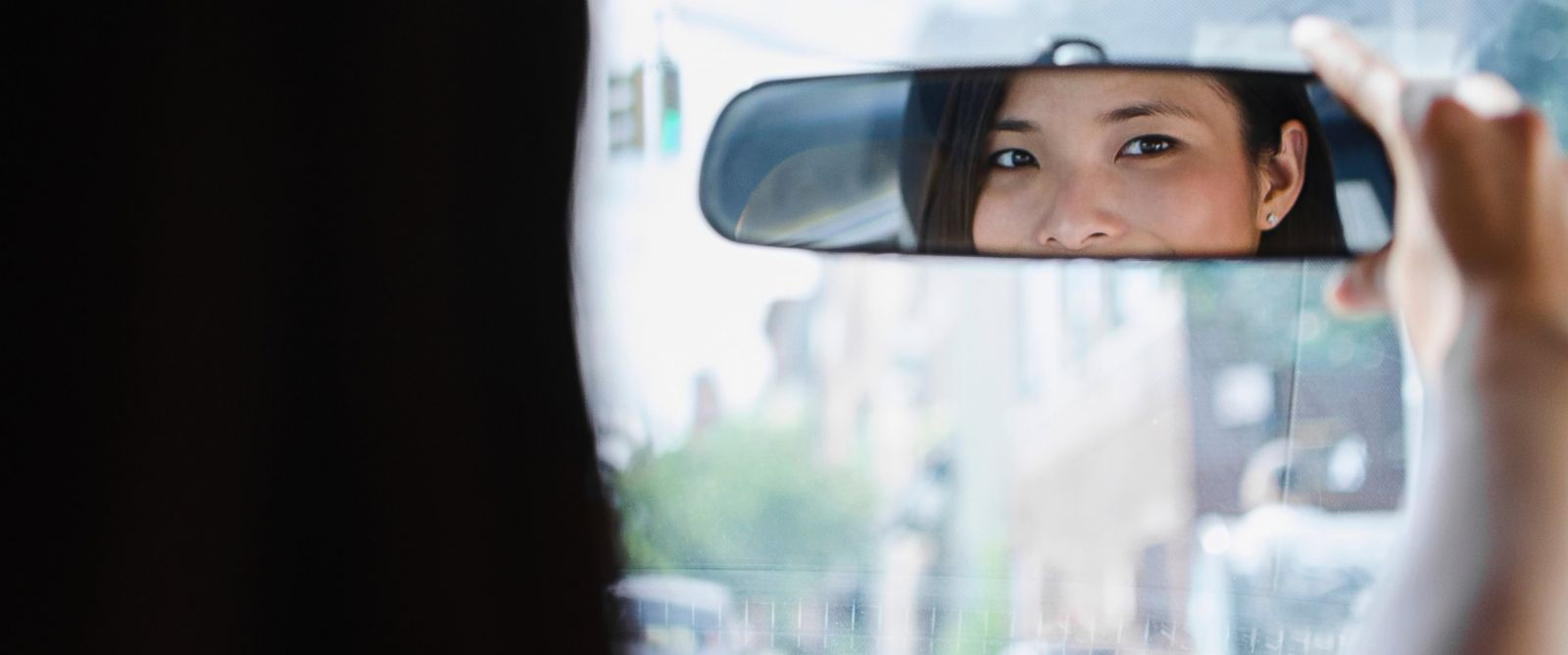 PHOTO: A rear-view mirror, paired with a backup camera, can help you back your car up safely.