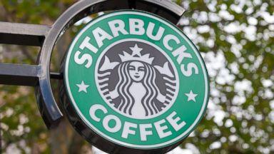 PHOTO: A Starbucks Corp. logo hangs outside one of the companys coffee shops in Hamburg, Germany, Nov. 9, 2013.