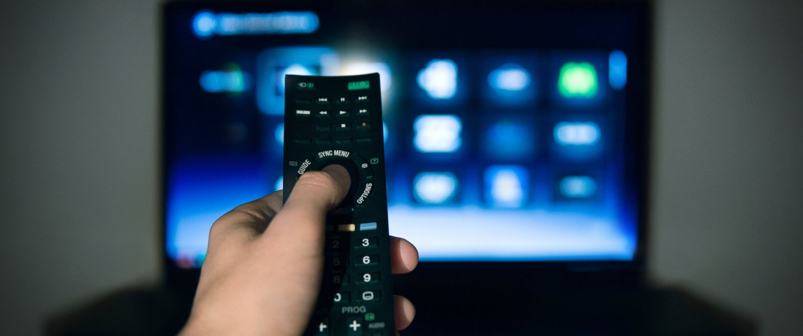 PHOTO: A man is pictured using a remote control for his television in this stock image.