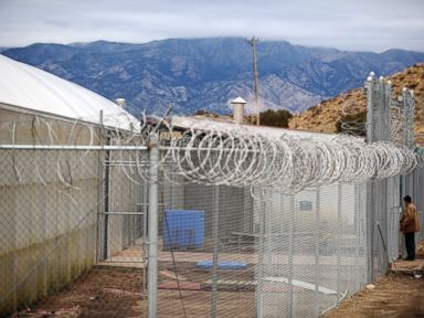 PHOTO:A Canon City Inmate working for Colorado Correctional Industries awaits entrance into a greenhouse housing tilapia fish at the East Canon City Prison Complex, in Canon City, Co., Nov.30, 2010.