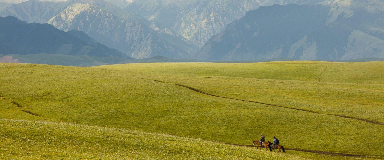 PHOTO: Horsemen travel through the Kalajun Mountain Area in Xinjiang.