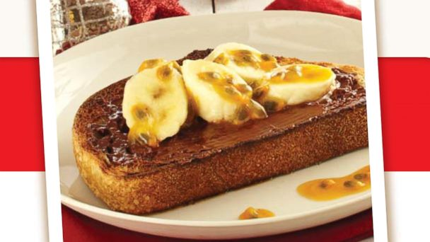 PHOTO: Toasted sourdough with Nutella spread, baked bananas, and passion fruit.