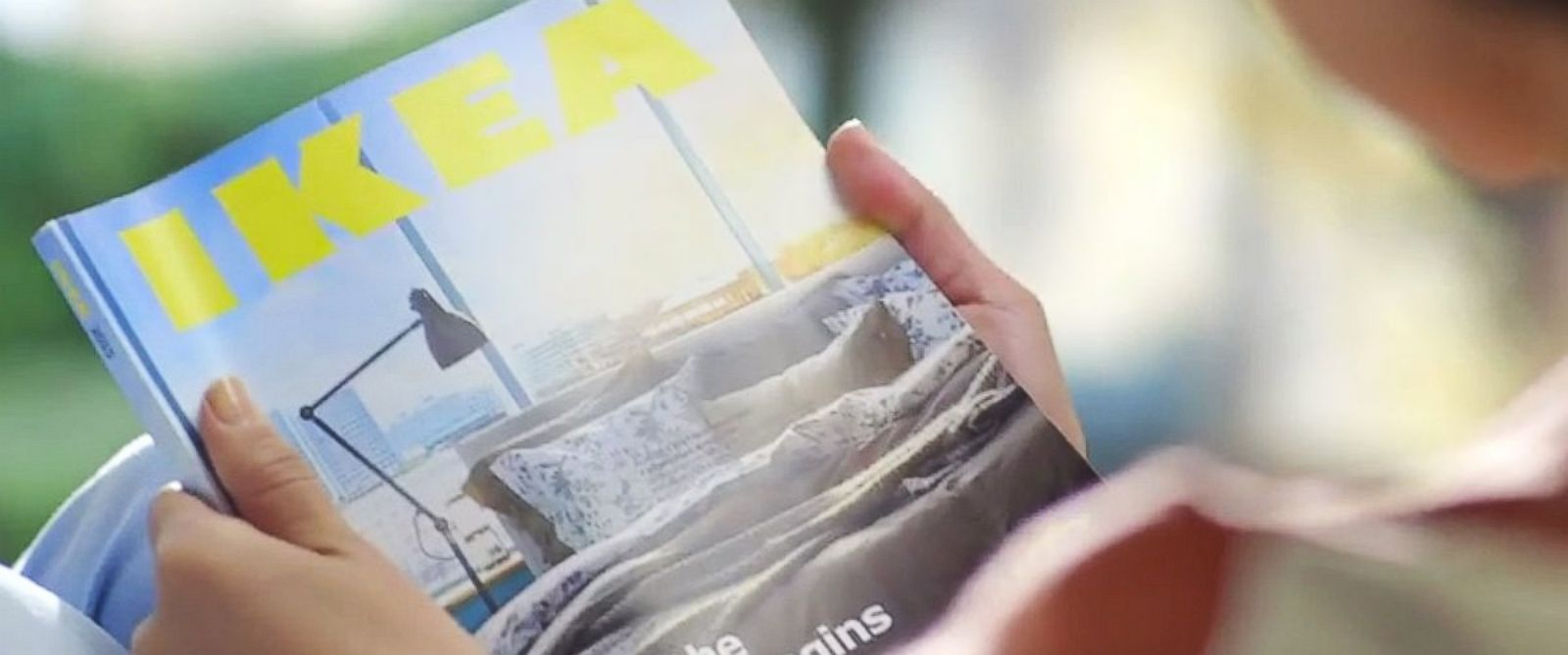 "PHOTO: The 2015 IKEA Catalogue is seen in this still from a YouTube video titled ""Experience the power of a bookbook."""