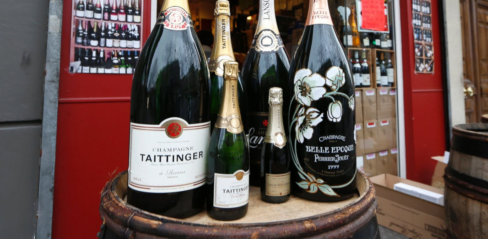 PHOTO: Various sizes of Champagne bottles are displayed in front of a wine shop in Paris, Dec. 21, 2012.