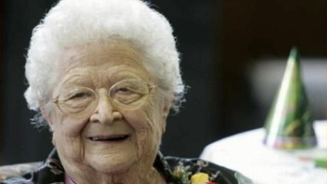 VIDEO: June Gregg, 100, holds original bank book noting first deposit made in 1913.
