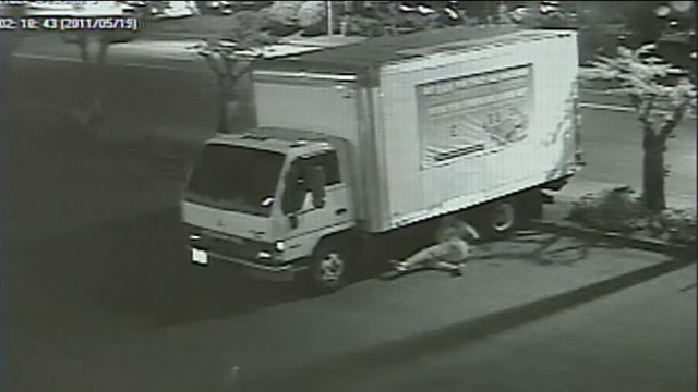 VIDEO: Security cameras film man cutting mattress stores delivery truck cables.